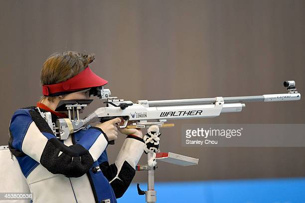 Sarah Hornung of Switzerland shoots during Day 3 of the 2014 Summer Youth Olympic Games of the Girls 10m Air Rifle Final Competition at the Fangshan...