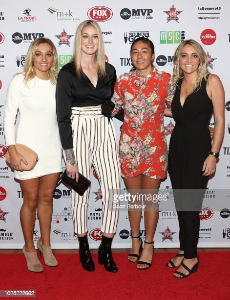 Sarah Hosking Tayla Harris Darcy Vescio and Jess Hosking of the Blues AFLW side pose during the 2018 AFL Players' MVP Awards at the Basement on...