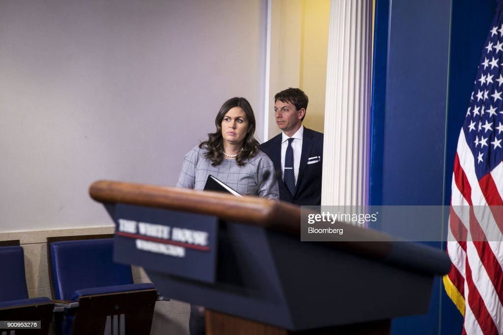 Sarah Huckabee Sanders, White House press secretary, left, arrives to a White House press briefing in Washington, D.C., U.S., on Wednesday, Jan. 3, 2018. President Donald Trump denounced his former top strategist, Steve Bannon, on Wednesday in a dramatic break from the man considered an architect of Trump's populist campaign. Photographer: Al Drago/Bloomberg via Getty Images