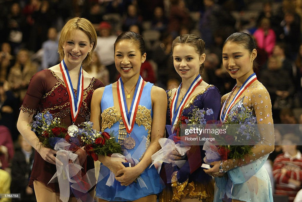 Sarah Hughes, Michelle Kwan, Sasha Cohen and Ann Patrice McDonough pose for photographers on the winner's podium during the State Farm US Figure Skating Championships on January 18, 2003 at the American Airlines Center in Dallas, Texas. Hughes finished second. Kwan finished first. Cohen finished third and McDonough finished fourth.
