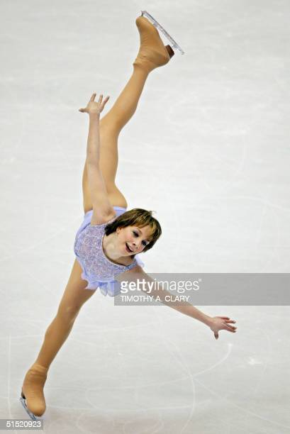 Sarah Hughes performs the women's free program of the figure skating event at the Olympic Ice Center 21 February 2002 during the XIXth Winter...