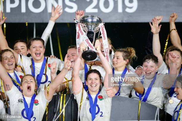 Sarah Hunter of England and Marlie Packer of England as the England team celebrate becoming Grand Slam Champions following the Women's Six Nations...