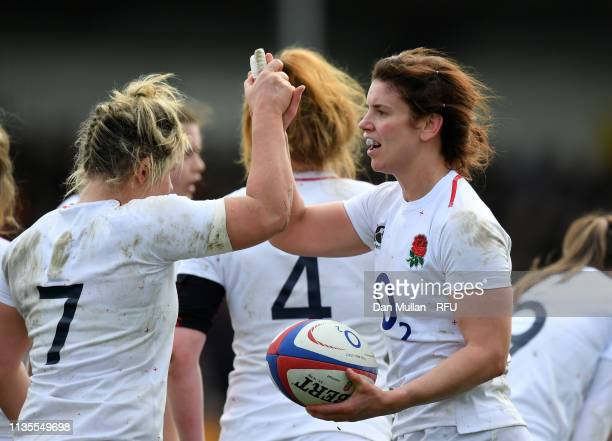 Sarah Hunter of England celebrates with Marlie Packer of England during the Womens Six Nations match between England and Italy at Sandy Park on March...