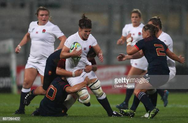 Sarah Hunter of England is hauled down by the French defence during the Women's Rugby World Cup 2017 Semi Final match between England and France at...