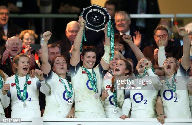 Sarah Hunter of England lifts the trophy after victory after the Old Mutual Wealth Series match between England and Canada at Twickenham Stadium on...