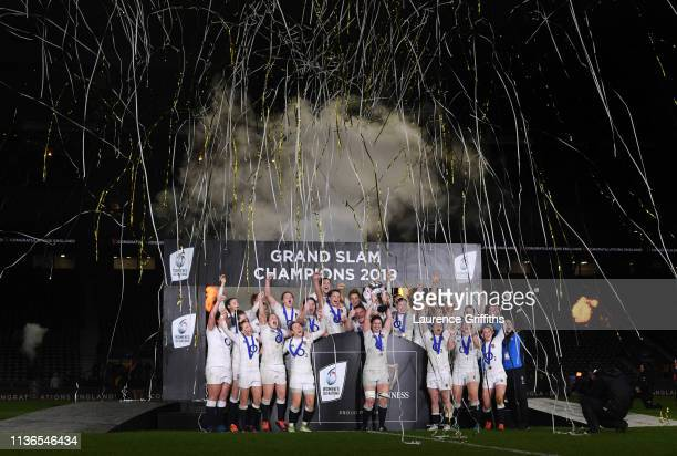 Sarah Hunter of England lifts the trophy as the England team celebrate becoming Grand Slam Champions following the Women's Six Nations match between...