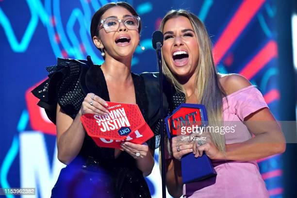 Sarah Hyland and Jessie James Decker speak onstage at the 2019 CMT Music Awards at Bridgestone Arena on June 05, 2019 in Nashville, Tennessee.