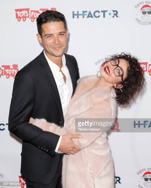 Sarah Hyland and Wells Adams attend the 6th annual Winter Wonderland Toys for Tots Party hosted by Katie Welch and Jordan Kuker on December 11 2018...