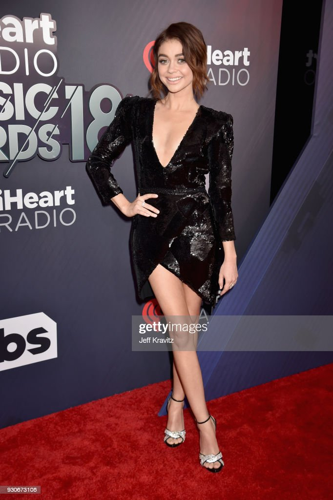 Sarah Hyland arrives at the 2018 iHeartRadio Music Awards which broadcasted live on TBS, TNT, and truTV at The Forum on March 11, 2018 in Inglewood, California.