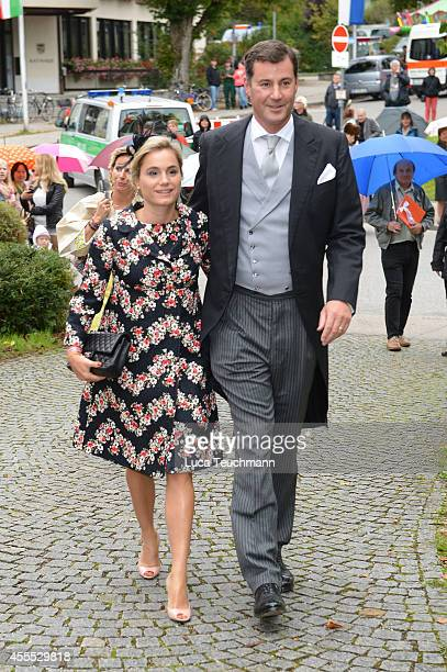 Sarah Isenburg and Alexander von Isenburg arrive for the wedding of Maria Theresia Princess von Thurn und Taxis and Hugo Wilson at St Joseph Church...