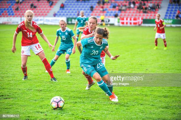 Sarah Jabbes of Germany challenges Emma Snerle of Denmark during the Nordic Cup 2017 match between U16 Girl's Germany and U16 Girl's Norway on July 4...