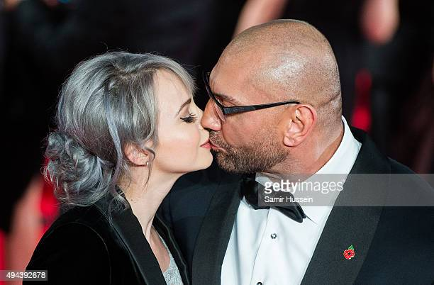 Sarah Jade and Dave Bautista attend the Royal Film Performance of 'Spectre' at Royal Albert Hall on October 26 2015 in London England