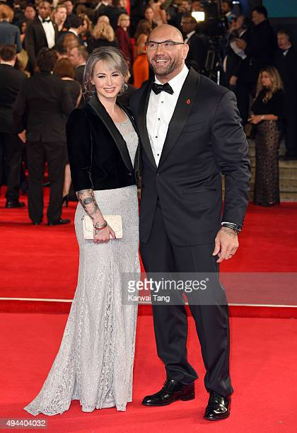 Sarah Jade and Dave Bautista attend the Royal Film Performance of 'Spectre' at the Royal Albert Hall on October 26 2015 in London England