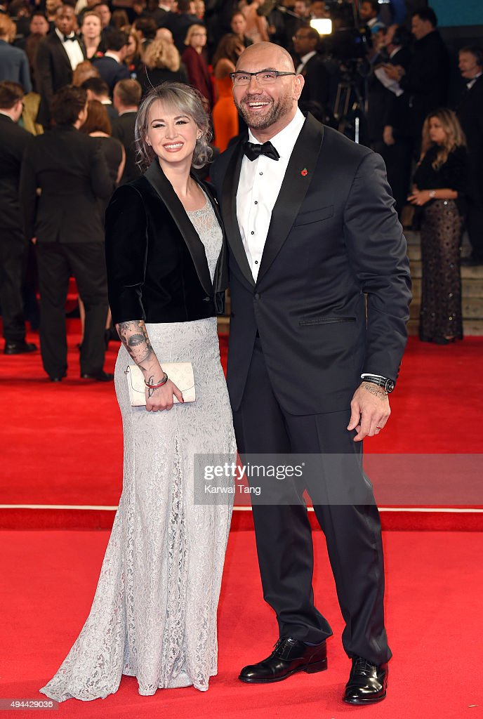 Sarah Jade and Dave Bautista attend the Royal Film Performance of 'Spectre' at the Royal Albert Hall on October 26, 2015 in London, England.