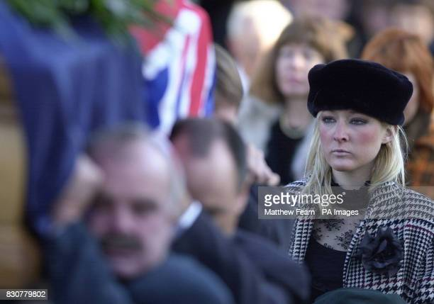 Sarah Jane Blake watches as the coffin of her father yachtsman Sir Peter Blake is carried from St ThomasABecket parish church in Warblington...