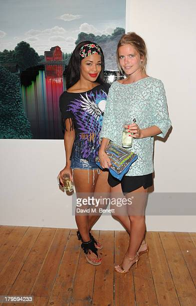 Sarah Jane Crawford and Katie Redman attends the VIP launch of the 'Hand To Earth' exhibition hosted by Matthew Williamson at Scream Gallery on...