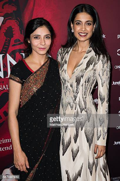 Sarah Jane Dias and Pegah Ferydoni during the '7 Goetinnen' German Premiere at Kino in der Kulturbrauerei on June 1 2016 in Berlin Germany