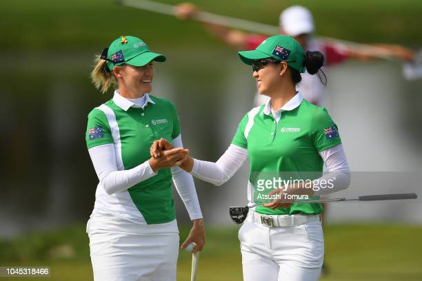 Sarah Jane Smith and Minjee Lee of Australia shake hands on the 17th green in the Pool A match between England and Australia on day one of the UL...