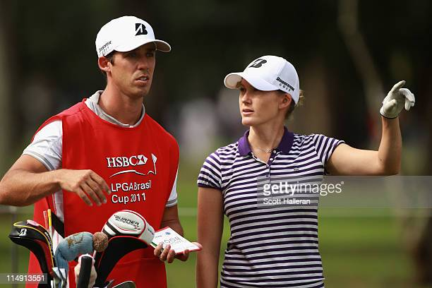 Sarah Jane Smith of Australia chats with her caddie on the 17th hole during the first round of the HSBC LPGA Brazil Cup at the Itanhanga Golf Club on...