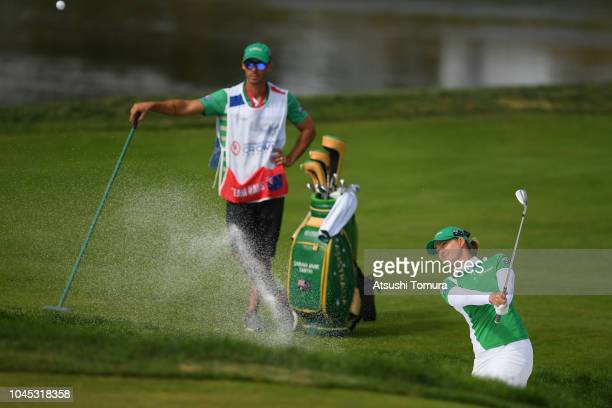 Sarah Jane Smith of Australia hits out from a bunker on the 17th hole in the Pool A match between England and Australia on day one of the UL...