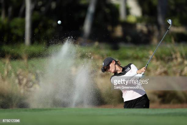 Sarah Jane Smith of Australia plays a shot from a bunker on the 17th hole during round one of the CME Group Tour Championship at the Tiburon Golf...