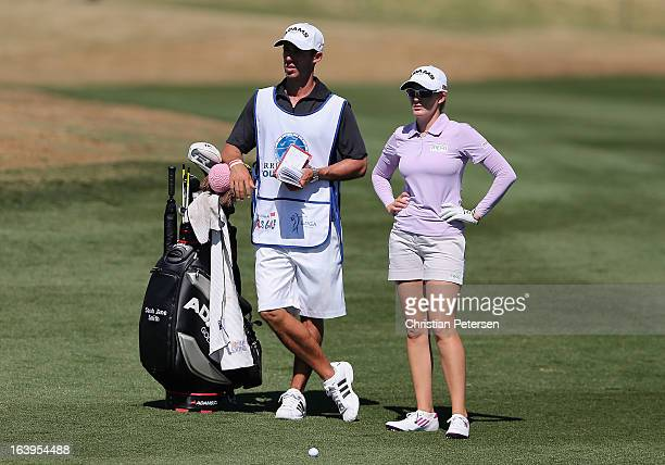 Sarah Jane Smith of Australia stands with her caddie and bag during the first round of the RR Donnelley LPGA Founders Cup at Wildfire Golf Club on...