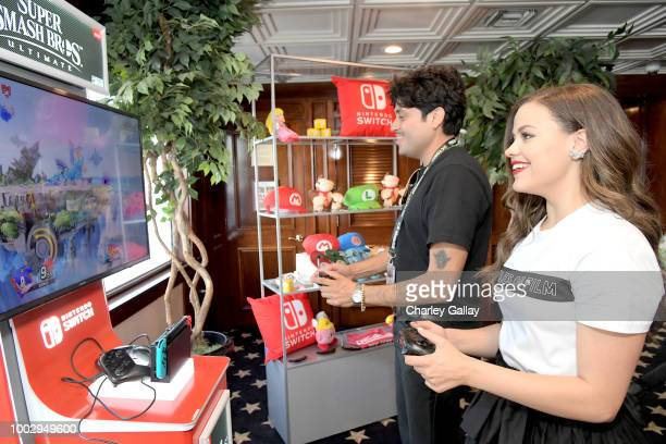 Sarah Jeffery tests her skills on Super Smash Bros Ultimate for Nintendo Switch at the Variety Studio at ComicCon 2018 on July 20 2018 in San Diego CA