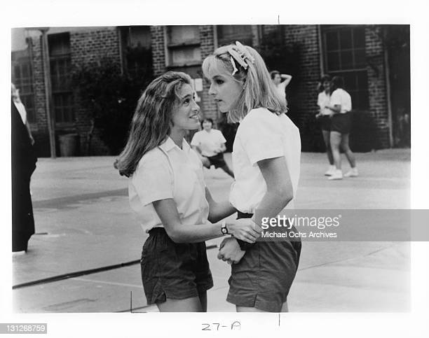Sarah Jessica Parker and Helen Hunt on the playground of their all girls Catholic school in a scene from the film 'Girls Just Want To Have Fun' 1985