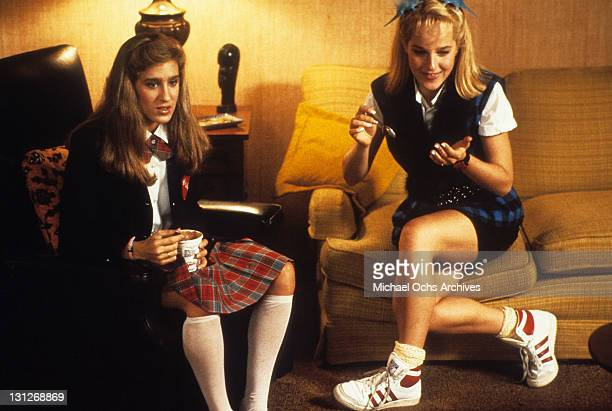 Sarah Jessica Parker and Helen Hunt watching TV at home in a scene from the film 'Girls Just Want To Have Fun' 1985