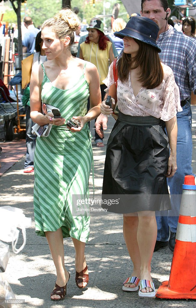Sarah Jessica Parker and Kristin Davis during Sex And The City Cast on Location in Soho at Soho in New York City, New York, United States.