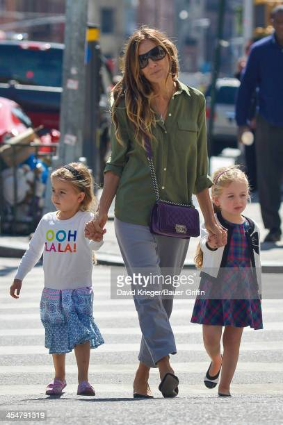 Sarah Jessica Parker holds hands with her twin daughters Marion Loretta and Tabitha while shopping in downtown Mahattan on September 15 2013 in New...