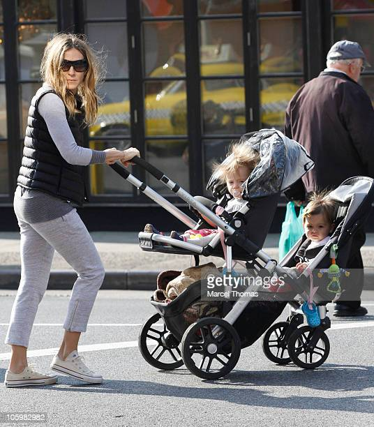 Sarah Jessica Parker is seen with her twin daughters Marion and Tabitha Broderick on the streets of Manhattan on October 23 2010 in New York New York
