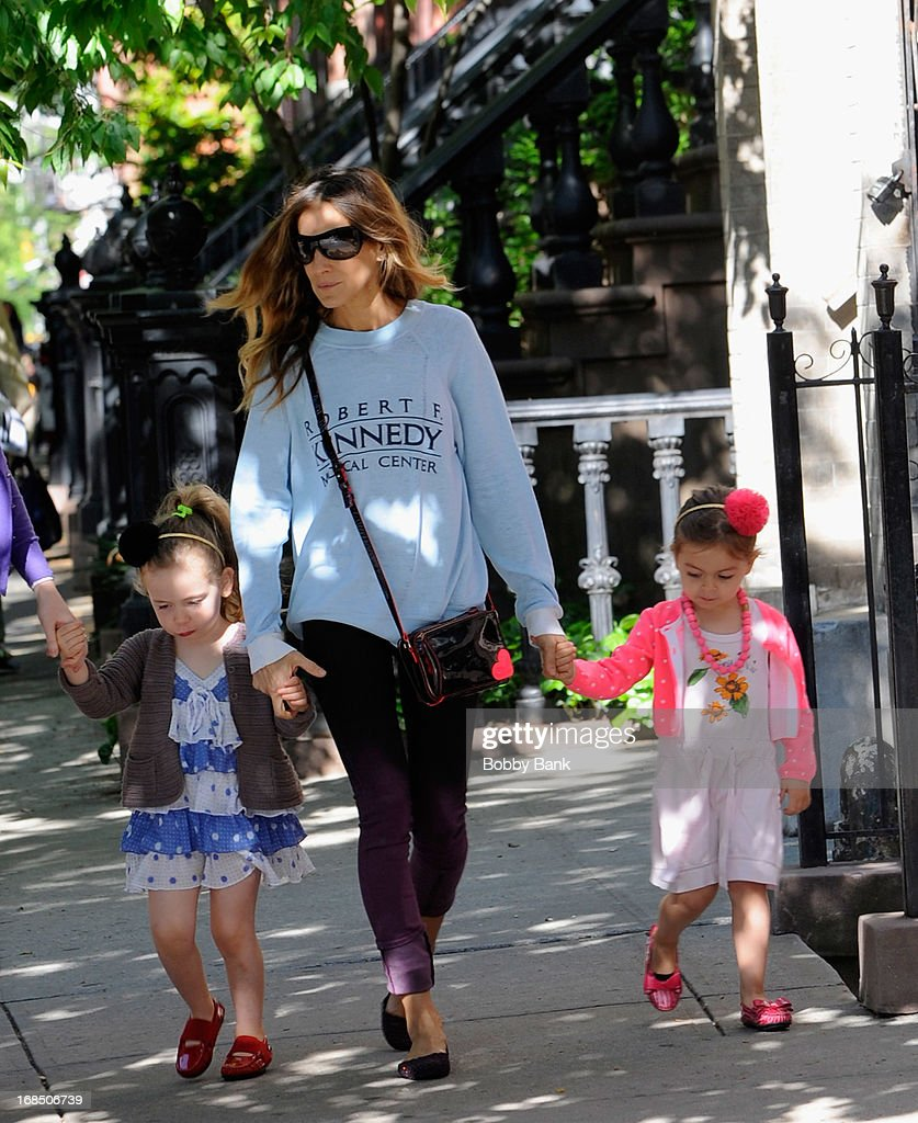 Sarah Jessica Parker with her twin daughters, Tabitha Broderick and Marion Broderick in the West Village on May 10, 2013 in New York City.