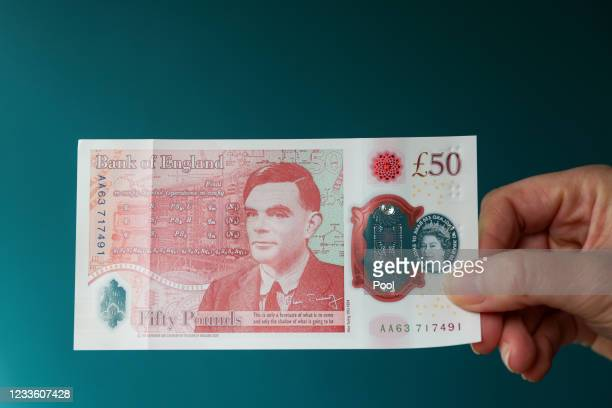 Sarah John, chief cashier of the Bank of England, poses with a new 50-pound banknote at Daunt Books on June 23, 2021 in London, England. The new £50...