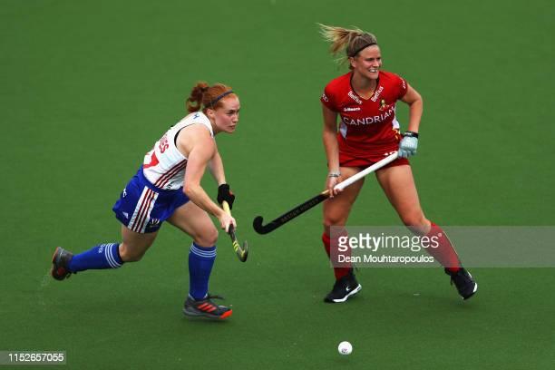 Sarah Jones of Great Britain battles for the ball with Alix Gerniers of Belgium during the Women's FIH Field Hockey Pro League match between Belgium...