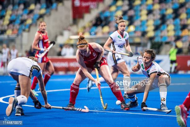 Sarah Jones of Great Britain challenges for the ball with Selin Oruz of Germany during the Women's FIH Field Hockey Pro League match between Germany...