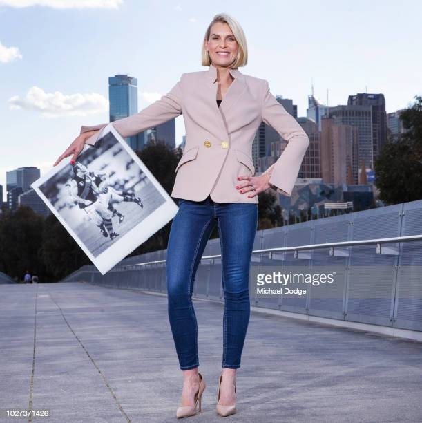 Sarah Jones shows off her favorite moment with a polaroid of Tim Watson in the 1993 Grand Final during the FOX FOOTY AFL Finals Series Launch at...