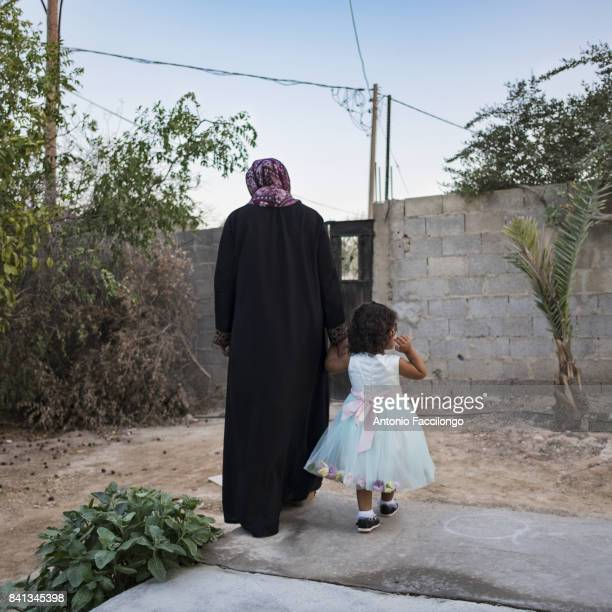 Sarah Ka'abneh in her garden with her twoyearold daughter Rafeef who was born through IVF Her husband was sentenced to 2 life imprisonmentsThis photo...