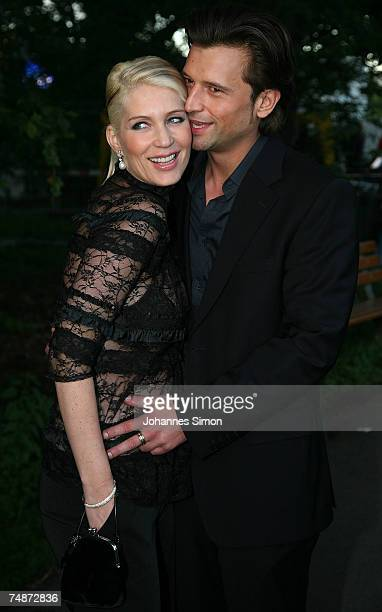 Sarah Kern and her boyfriend Goran Munizaba arrive the DTM Come Together party on June 23 2007 in Nuremberg Germany