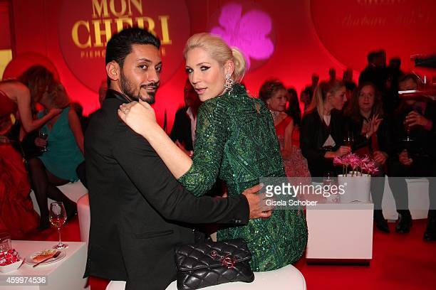 Sarah Kern and her fiance Alieu during the Mon Cheri Barbara Tag 2014 at Haus der Kunst on December 4 2014 in Munich Germany