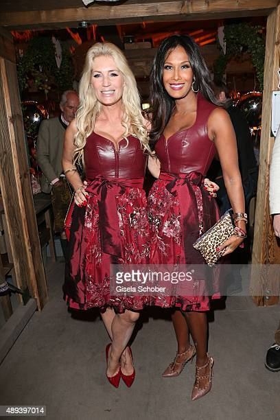 Sarah Kern and Marie Amiere wearing the same dirndl dress by Astrid Soell during the Almauftrieb during the Oktoberfest 2015 at Kaeferschaenke beer...