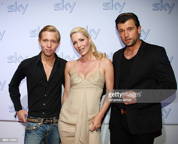 Sarah Kern her son Olivier and her husband Goran Munizaba arrive for the Sky pay TV channel launch at Schrannenhalle on July 3 2009 in Munich Germany