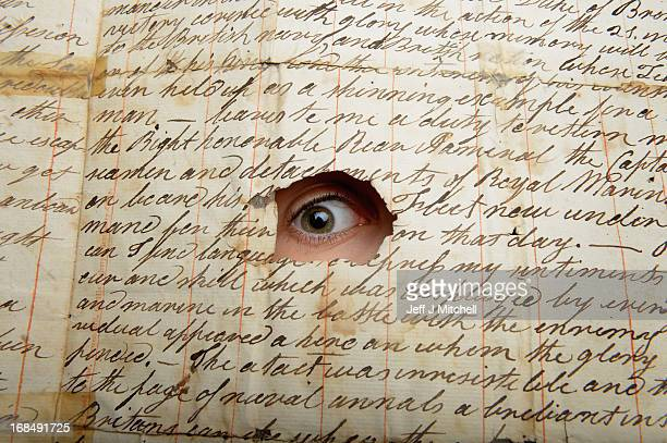 Sarah Kiedron of Lyon and Turnbull looks through a hole in a letter from a midshipman Robinson due to be auctioned on 13th May and is valued at...