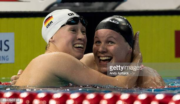 Sarah Koehler of Germany and Julia Hassler of Lithuania celebrate together after the Women's 400m Final during the European Short Course Swimming...
