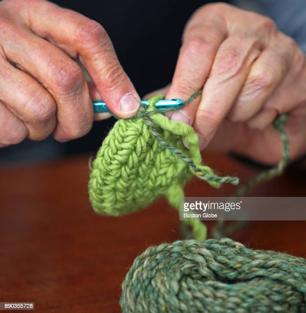 Sarah Kuhn a psychology professor at UMass Lowell crochets one of her homemade holiday gifts in Lowell MA on Nov 21 2017 Instead of rushing out to...