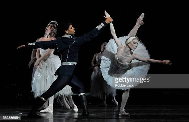 Sarah Lamb as Odette and Carlos Acosta as Prince Siegfried with artists of the company in the Royal Ballet's production of Marius Petipa and Lev...
