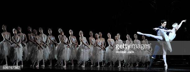 Sarah Lamb as Odette and Federico Bonelli as Prince Siegfried with artists of the company in the Royal Ballet's production of Marius Petipa and Lev...