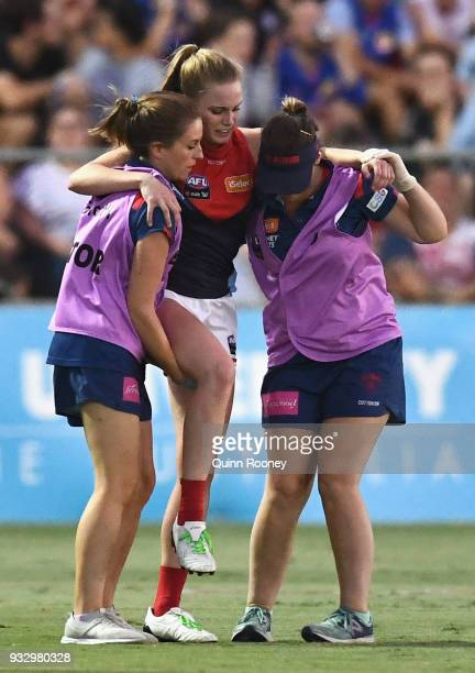 Sarah Lampard of the Demons is hepled from the ground by trainers during the round seven AFLW match between the Western Bulldogs and the Melbourne...