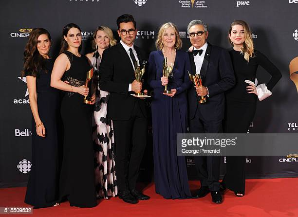 Sarah Levy Emily Hampshire Jennifer Robertson Daniel Levy Catherine O'Hara Eugene Levy and Annie Murphy pose in the press room at the 2016 Canadian...