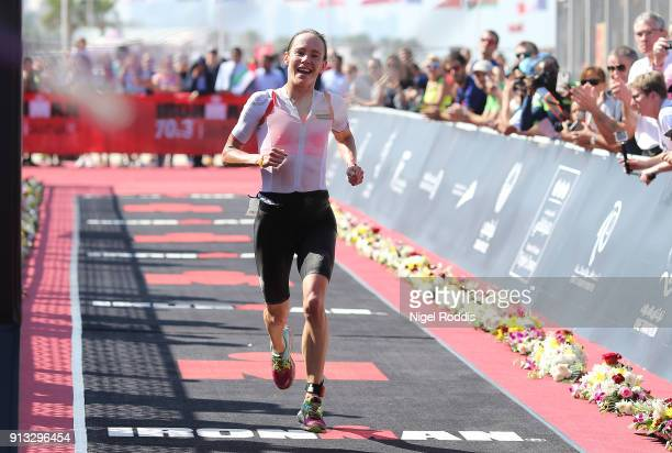 Sarah Lewis of Great Britain finishes second in the women's race Ironman 703 Dubai on February 2 2018 in Dubai United Arab Emirates